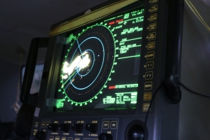 The monitor displays seabirds flying by the radar survey area